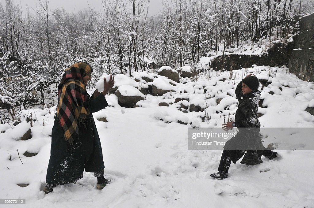 Kashmiri children enjoying snow ball fight on February 12, 2016 on the outskirts of Srinagar, India. Incessant snowfall and rains on Thursday led to the closure of the valleys arterial Srinagar-Jammu National Highway and brought relief from a long spell of dry weather in Kashmir.