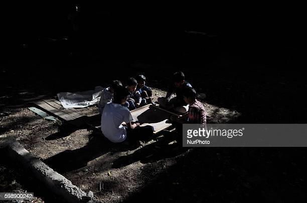 Kashmiri Children play a Game of carrom inside a local graveyard during a curfew in old city Srinagar on September 32016Schools in Kashmir have been...