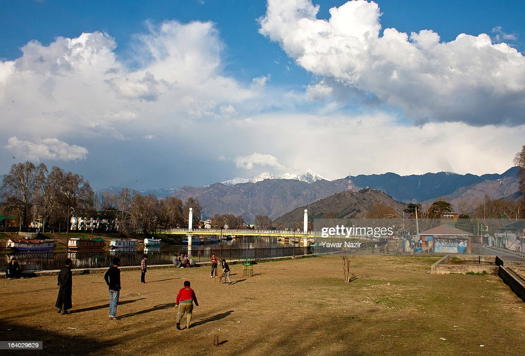 Kashmiri Children play cricket on the bank of river Jehlum on March 19, 2012 in Srinagar the summer capital of Indian administered Kashmir, India. Kashmir has been a contested land between nuclear neighbors India and Pakistan since 1947, the year both the countries attained freedom from the British. Since 1947 the ownership of Kashmir has been disputed between Pakistan, India and China.