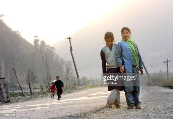 Kashmiri children play next to the now empty SrinagarMuzaffarabad road that once linked India to Pakistan March 17 near the village of Uri India With...