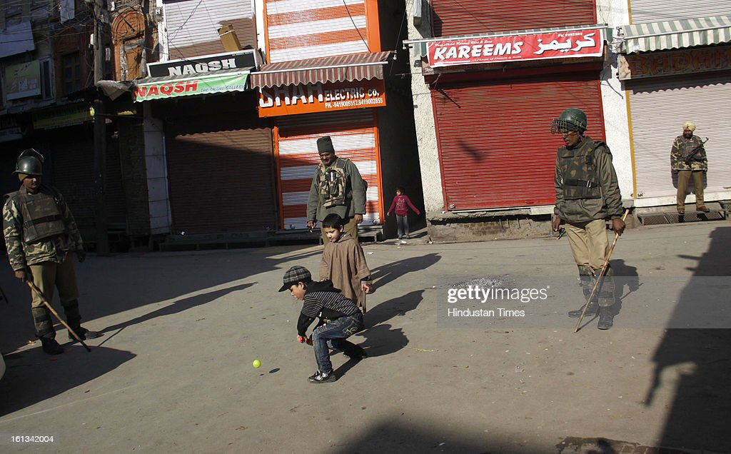 Kashmiri children's are playing on deserted street after the parliament attack convict, Muhammad Afzal Guru was hanged in New Delhi, during Second day curfew on February 10, 2013 in Srinagar, India. Guru, who was found guilty of conspiring and sheltering the militants who attacked Parliament on December 13, 2001 in which nine people were killed, was buried in the prison premises as per the jail manual.