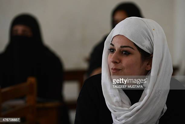 A Kashmiri college student looks on on the first day of the schooling session at Women's College in Srinagar on March 5 2014 Schools and colleges in...