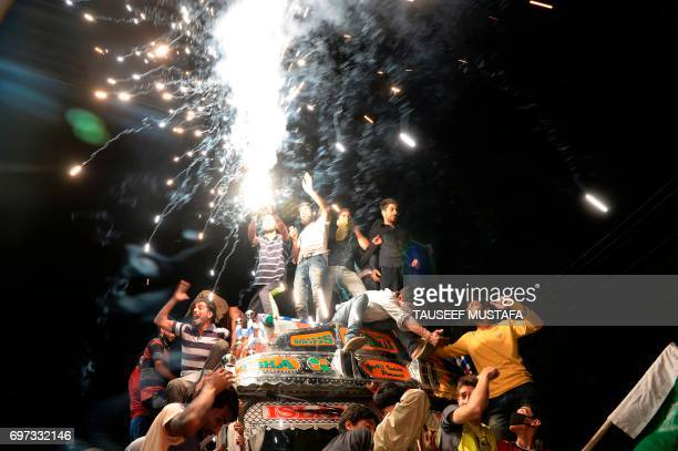 TOPSHOT Kashmiri cricket fans celebrate after Pakistan's win in the International Cricket Championship Champions Trophy final cricket match against...