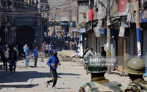 Kashmiri demonstrators clash with police during a protest against a government proposal to create exclusive settlements for Kashmiri Hindus in...
