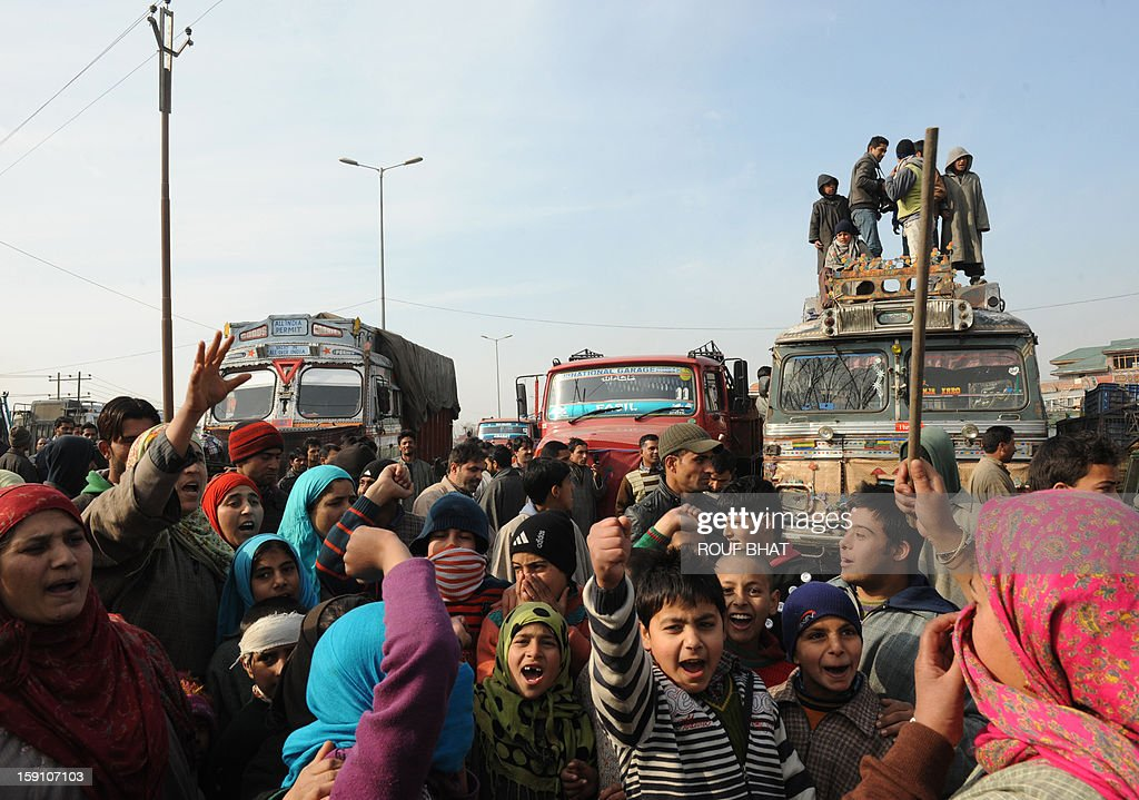 Kashmiri demonstrators shout slogans as they block a highway during a protest against electricity shortages in Srinagar on January 8, 2013. Kashmir Valley continued to reel under intense cold with temperatures plummeting further as Srinagar recorded the season's lowest of minus 5.5 degrees Celsius. AFP PHOTO/ Rouf BHAT