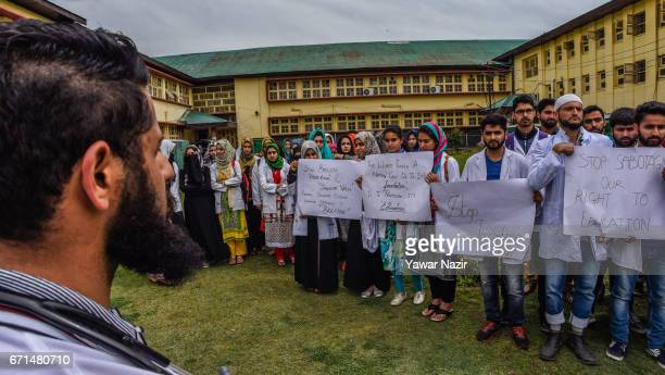 Kashmiri doctors hold placards during a protest demonstration against the harassment and thrashing of Kashmiri students studying in different Indian...