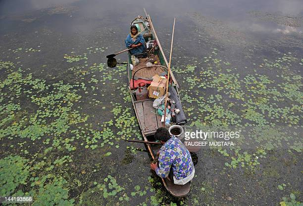 Kashmiri fisherman rows a boat on the Dal Lake on a windy and rainy day in Srinagar on May 11 2012 Pakistan said that it would host the next round of...