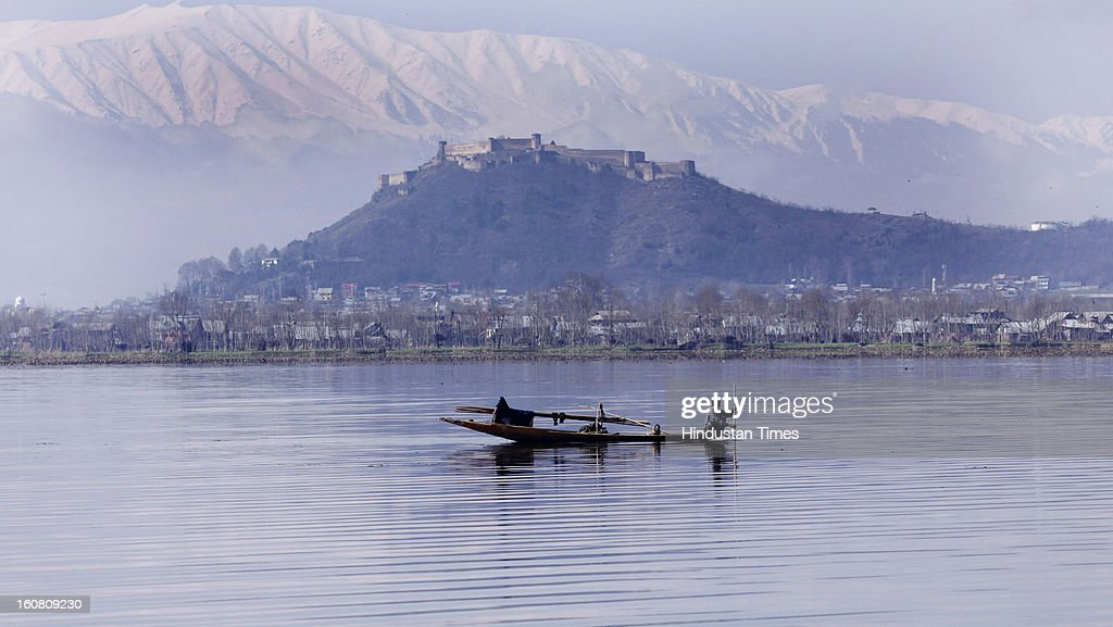 A Kashmiri fisherman rows his boat during a sunny day at Dal Lake, on February 6, 2013 in Srinagar, India. After two days of intermittent snow and rain weather improved in Kashmir. .