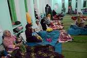 Kashmiri flood victims took refuge in a mosque as their residential houses are submerged in flood waters on September 11 2014 in Srinagar the summer...