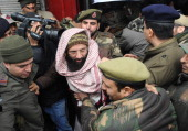Kashmiri former rebel commander MushtaqulIslam is detained by Indian police following a meeting to protest last year's hanging of parliament attack...