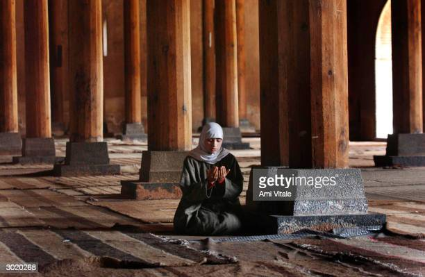 Kashmiri girl waits for Friday afternoon prayers to begin inside the main mosque February 27 2004 in Srinagar India Earlier February 27 an attack on...