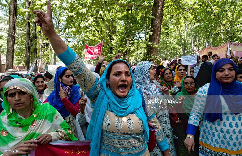 Kashmiri government contractual workers and daily wagers from various labour groups shout slogans as they stage a protest marking the International Labor Day Labor Day on May 01, 2016 in Srinagar, the summer capital of Indian administered Kashmir, India. Hundreds of Kashmiri government contractual workers and daily wagers from various labour groups took part in a rally on International Labor Day and staged a demonstration to draw attention to their hardships caused by the delay in fulfilling their demands. The demonstrators demanded an increase in their salary. The protest march was organized by Communist Party of India.