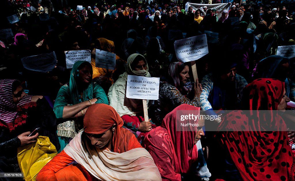 Kashmiri government contractual workers and daily wagers from various labour groups hold placards during a protest marking the International Labor Day on May 01, 2016 in Srinagar, the summer capital of Indian controlled Kashmir, India. Hundreds of Kashmiri government contractual workers and daily wagers from various labour groups took part in a rally on International Labor Day in Kashmir to press for their demands on the occasion of the International Labour Day. The protest march was organized by Communist Party of India.