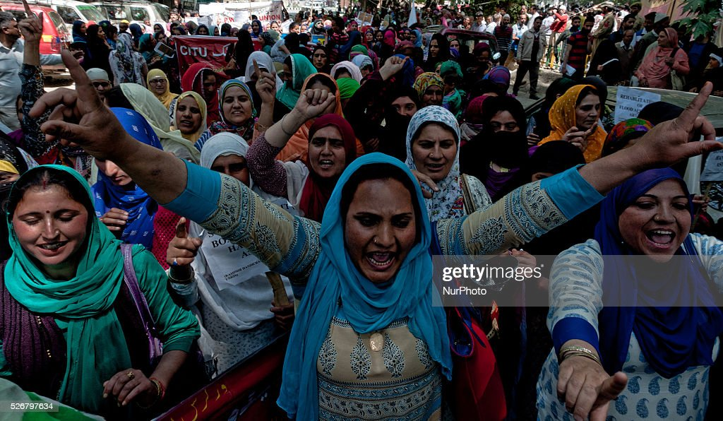 Kashmiri government contractual workers and daily wagers from various labour groups shout slogans during a protest marking the International Labor Day on May 01, 2016 in Srinagar, the summer capital of Indian controlled Kashmir, India. Hundreds of Kashmiri government contractual workers and daily wagers from various labour groups took part in a rally on International Labor Day in Kashmir to press for their demands on the occasion of the International Labour Day. The protest march was organized by Communist Party of India.