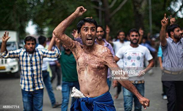 Kashmiri government employees shout slogans during a protest against the government on August 10 2015 in Srinagar the summer capital of Indian...