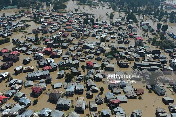 Kashmiri houses submerged by floodwaters are seen from an Indian Air Force helicopter during rescue and relief operations in Srinagar on September 10...