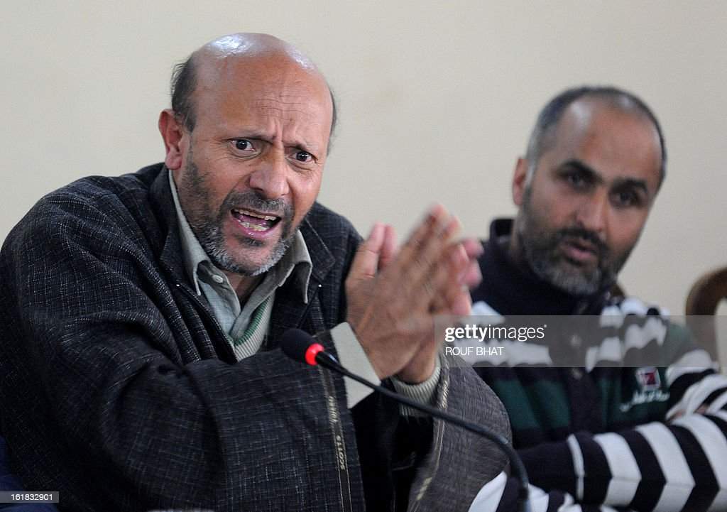 Kashmiri lawmaker Sheikh Abdul Rashid, locally known as Engineer Rashid, (L) addresses a press conference in Srinagar on February 17, 2013. Rashid demanded the return of the mortal remains of Kashmiri separatist Mohammed Afzal Guru to his family. Mohammed Afzal Guru was executed on February 9, 2013 and buried inside a high security prison in New Delhi over his role in a deadly attack on Indian parliament in New Delhi in 2001. AFP PHOTO/ Rouf BHAT