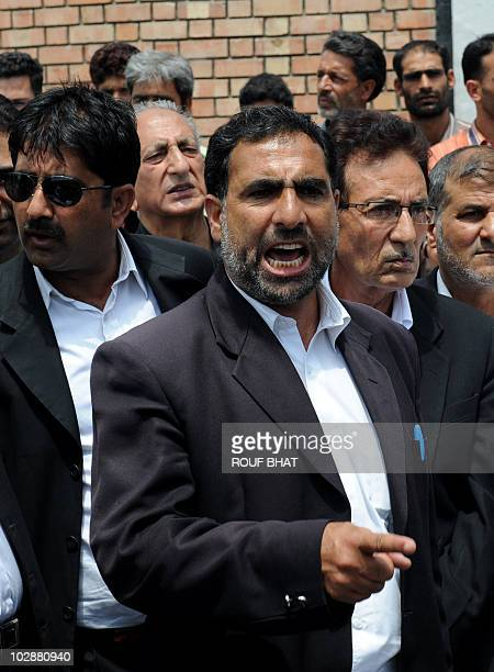 Kashmiri lawyers listen as one of their number shouts profreedom slogans during a sitin protest in Srinagar on July 14 2010 The lawyers were...