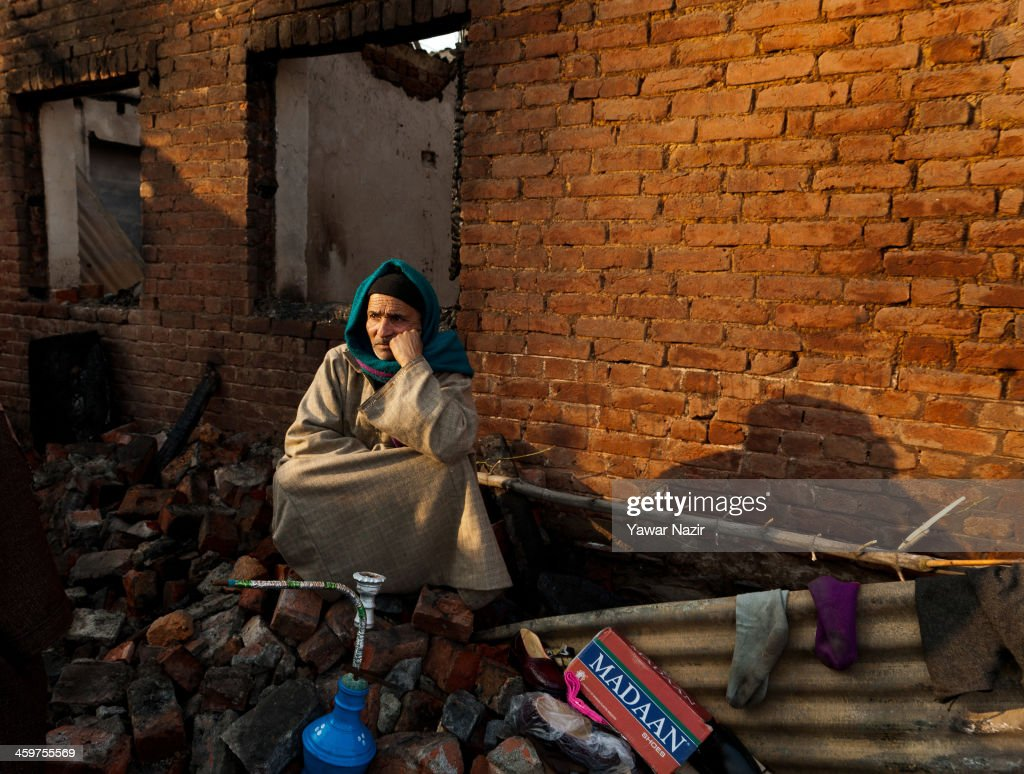 A Kashmiri man rests on the debris of his house after a fire gutted many residential houses on December 30, 2012, in Srinagar, the summer capital of Indian administered Kashmir, India. Many families were left homeless amid sub-zero temperatures during the harshest 40-day period (Chilay Kalan) of the winter, after at least 30 residential houses were damaged in a devastating fire on the bank of famous Dal Lake near the Hazratbal shrine, in the outskirts of the Srinagar. The incident engulfed the area during the preceding night, an official said. No injuries were reported.