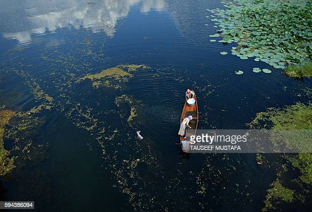 Kashmiri man rows a boat inside a Nigeen Lake in Srinagar on August 23 2016 Indianadministered Kashmir has been in the grip of almost daily antiIndia...