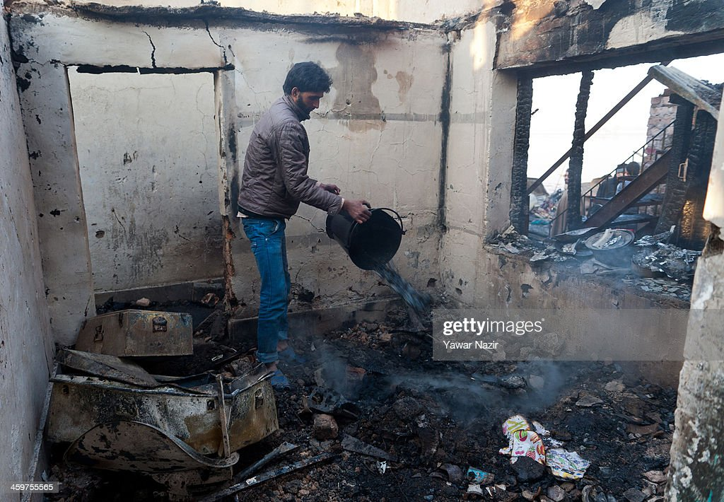 A Kashmiri man salvages belongings after a fire gutted many residential houses on December 30, 2012, in Srinagar, the summer capital of Indian administered Kashmir, India. Many families were left homeless amid sub-zero temperatures during the harshest 40-day period (Chilay Kalan) of the winter, after at least 30 residential houses were damaged in a devastating fire on the bank of famous Dal Lake near the Hazratbal shrine, in the outskirts of the Srinagar. The incident engulfed the area during the preceding night, an official said. No injuries were reported.