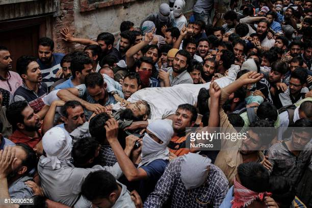 Kashmiri men carry the body of a local rebel Sajad Gilkar during his funeral Wednesday July 12 2017 in Srinagar Indianadministered Kashmir India...