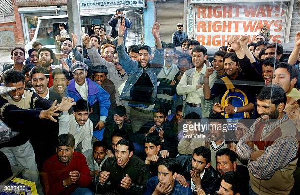 Kashmiri men cheer on the Pakistan team during the nailbiting finale of the cricket match between India and Pakistan in the first oneday...