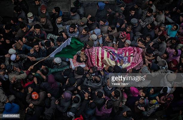 Kashmiri Mourners carry the body of Adil Sheikh a local pro Kashmir rebel killed in a gun battle with the Indian government forces during his funeral...