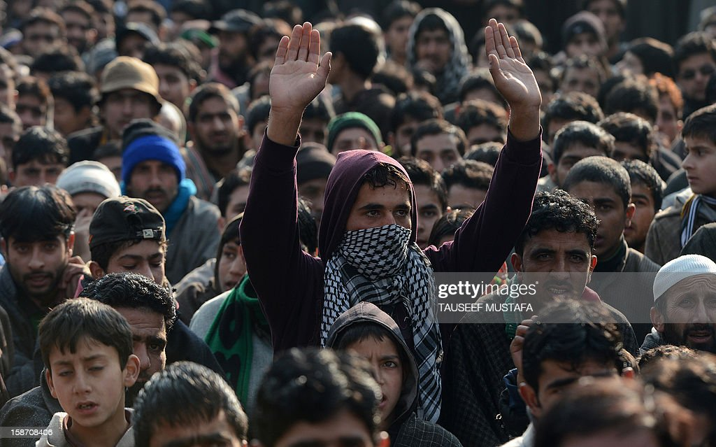 Kashmiri mourners shout slogans during a funeral of alleged Pakistan-based Lashker-e-Toiba militant Mudasir Sheikh alias Mavia a self styled 'district commander' and his Pakistani associate Tamim in Kulgam district of south Kashmir some 75kms from Srinagar on December 25, 2012. Security forces confronted the pair of rebels and in the ensuing gunbattle they and a policeman were killed. A police spokesman said that the two were implicated in an attack on The Silver Star Hotel in Srinagar and on an army convoy. AFP PHOTO/Tauseef MUSTAFA