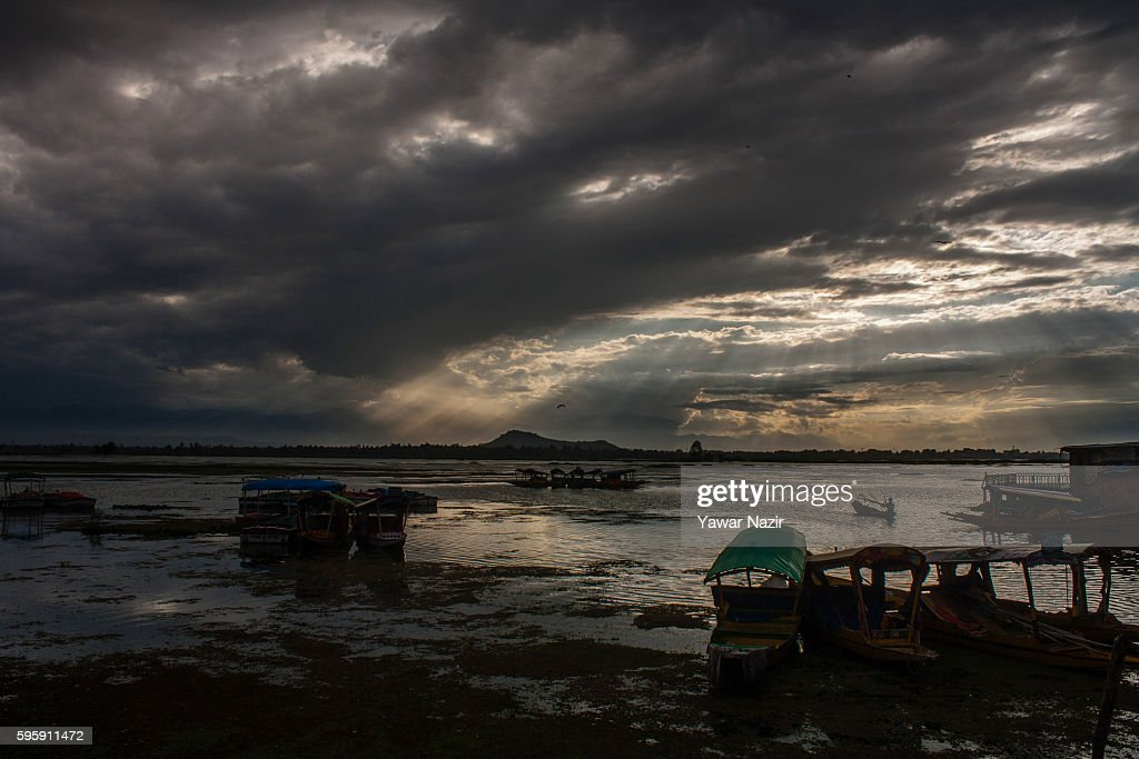 Kashmiri Muslim boat rows his boat on the Dal lake as the city remains under curfew a on August 26 2016 in Srinagar the summer capital of Indian...