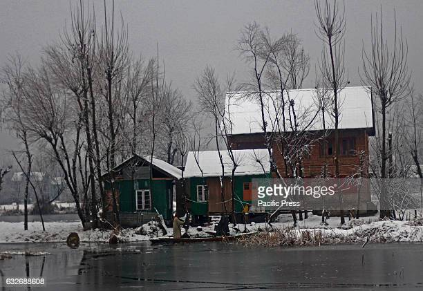 Kashmiri Muslim boatmen reach home after selling vegetables at the floating market The Valley continue to received snowfall from past couple of days...