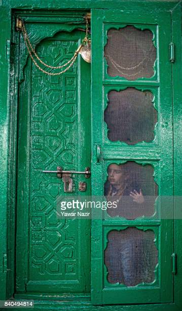 Kashmiri Muslim boy stands in front the door of the shrine of Khaniqahi mullah during a festival on August 29 2017 in Srinagar the summer capital of...