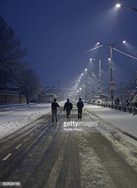 Kashmiri muslim boys leave to attend tuition classes early morning after the fresh snowfall in Srinagar the summer capital of Indian controlled...