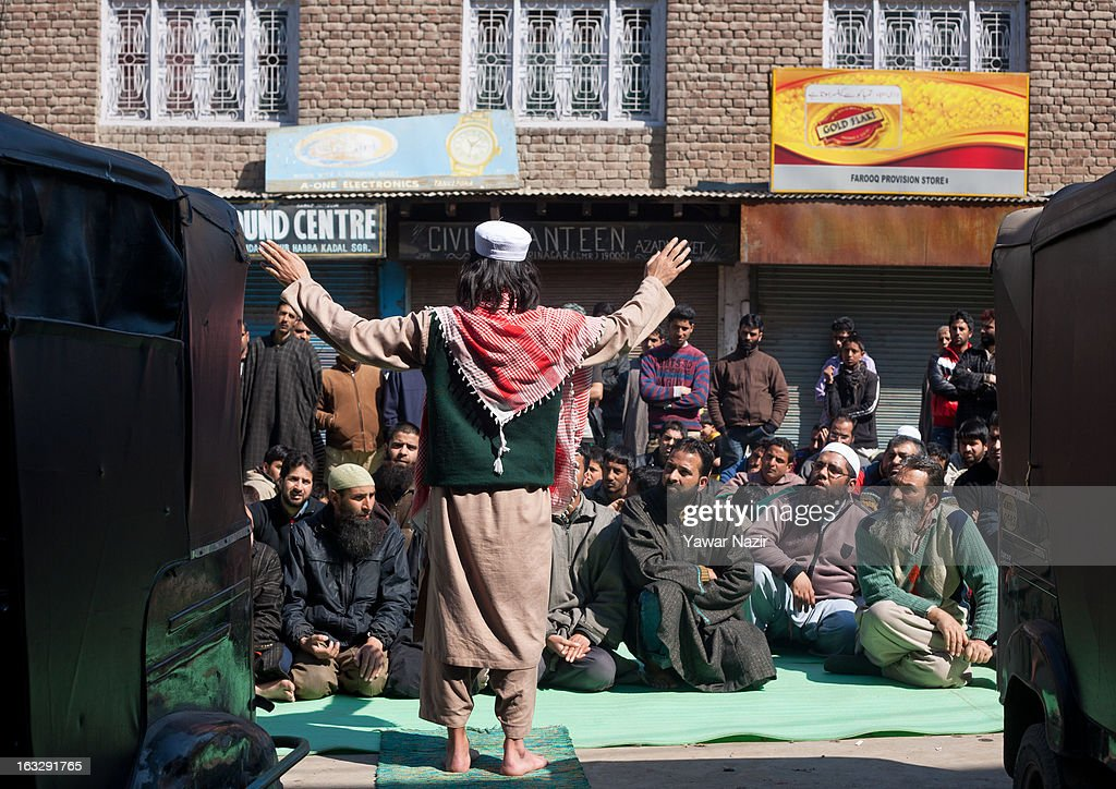 A Kashmiri Muslim cleric delivers a sermon to Muslims on a road as a mark of protest during a curfew-like restriction on March 7, 2013 in Srinagar, the summer capital of Indian Administered Kashmir, India. Clashes erupted in most parts of Kashmir today leaving scores of people injured. Meanwhile Indian authorities imposed curfew-like restrictions for the second consecutive day in most parts of Kashmir following the killing of a Kashmiri youth by the Indian army in North Kashmir's Baramulla district.
