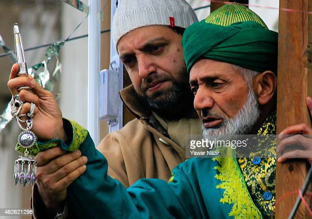 Kashmiri Muslim cleric displaying the holy relic to the Muslim devotees believed to be of Sufi Saint outside the Dastgeer Sahib shrine On the...