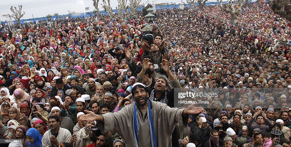 Kashmiri Muslim devotees raise their hands for prayers as a relic of Prophet Muhammad is displayed following Eid Milad-un Nabi marking the birth anniversary of Prophet Muhammad, at the Hazratbal shrine, on February 1, 2013 in Srinagar, India. Thousands of Kashmiri Muslims thronged the Hazratbal shrine, which houses a relic believed to be a hair from the beard of Prophet Mohammed.