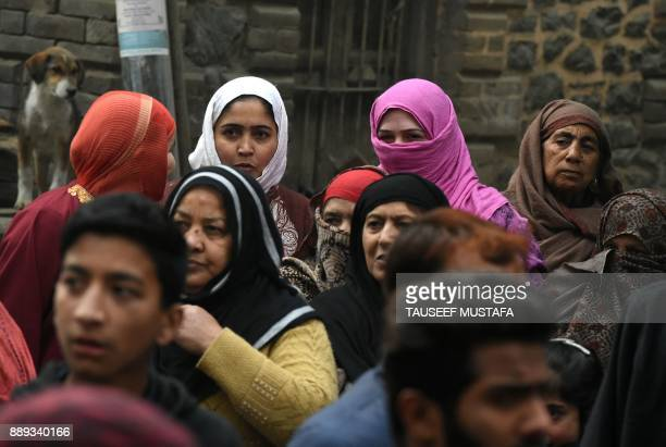 A Kashmiri muslim family look on during a protest led by senior separatist leader Yasin Malik on the occasion of the International Human Rights Day...