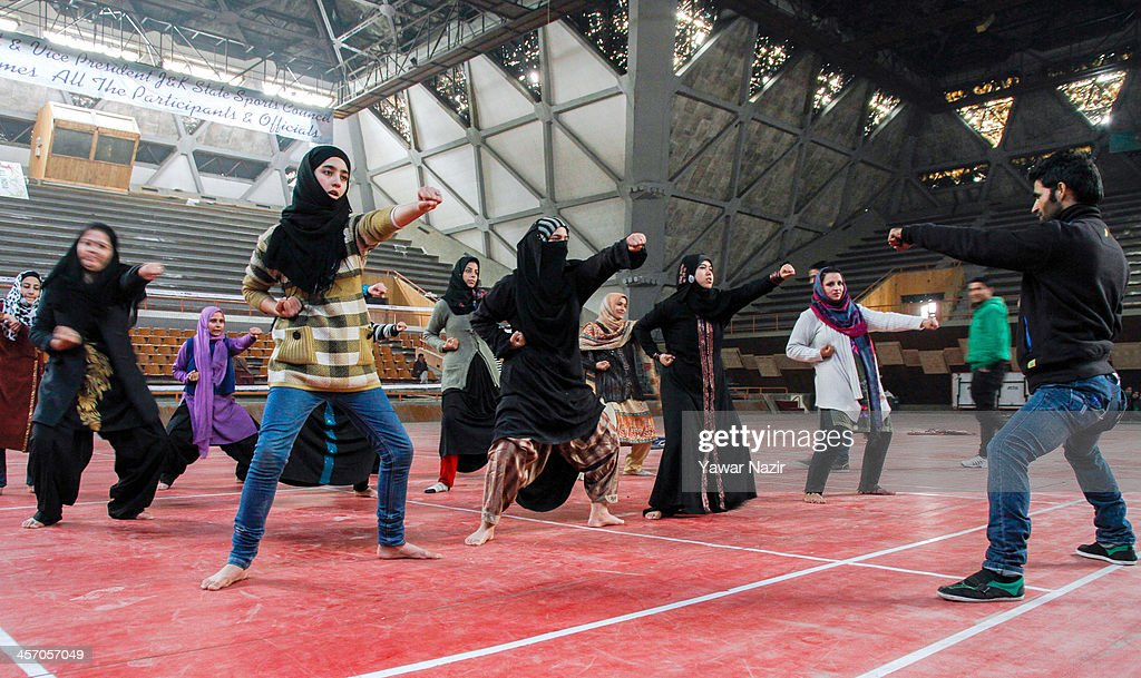 Kashmiri Muslim girls learn martial arts from a coach inside indoor stadium on December 16, 2013 in Srinagar, the summer capital of Indian administered Kashmir, India. As the number of crimes against women has risen in the region, girls from different age groups and backgrounds have taken up martial arts and other self defence courses to thwart attackers. Many believe after the barbaric rape and murder of a para-medic student last year on this day in the Indian capital of New Delhi, women in the Muslim majority state have taken to various martial arts forms like Thang-ta, a weapon-based Indian Martial art for protection.