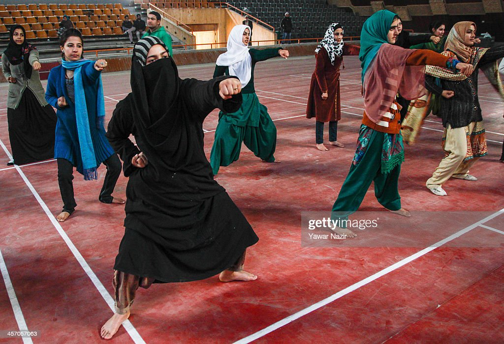 Kashmiri Muslim girls learn martial arts inside indoor stadium on December 16, 2013 in Srinagar, the summer capital of Indian administered Kashmir, India. As the number of crimes against women has risen in the region, girls from different age groups and backgrounds have taken up martial arts and other self defence courses to thwart attackers. Many believe after the barbaric rape and murder of a para-medic student last year on this day in the Indian capital of New Delhi, women in the Muslim majority state have taken to various martial arts forms like Thang-ta, a weapon-based Indian Martial art for protection.