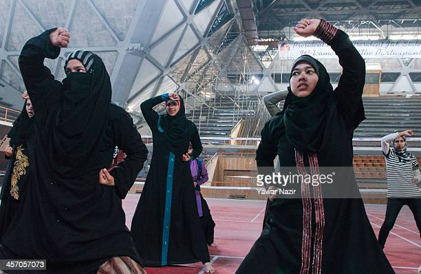 Kashmiri Muslim girls learn martial arts inside indoor stadium on December 16 2013 in Srinagar the summer capital of Indian administered Kashmir...