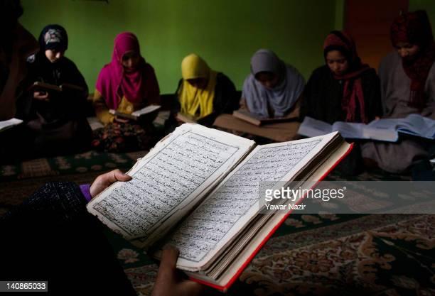 Kashmiri Muslim girls recite the Quran in GulshanEBannat Orphanage on March 7 2012 in Gopal Pora 16 Km west of Srinagar the summer capital of Indian...