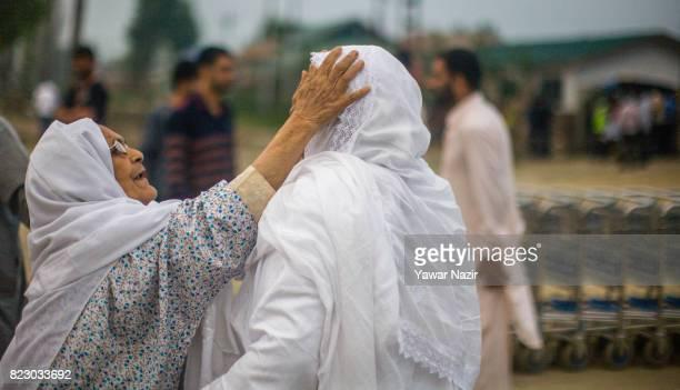 Kashmiri Muslim hajj pilgrim greets her daughter before departing for the annual Hajj pilgrimage to Mecca on July 26 2017 in Srinagar the summer...
