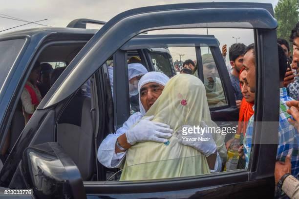 Kashmiri Muslim hajj pilgrim greets her relative before departing for the annual Hajj pilgrimage to Mecca on July 26 2017 in Srinagar the summer...