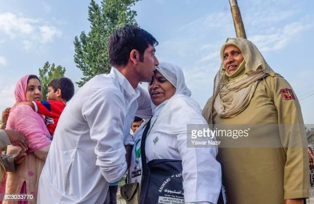 Kashmiri Muslim hajj pilgrim greets her son before departing for the annual Hajj pilgrimage to Mecca on July 26 2017 in Srinagar the summer capital...