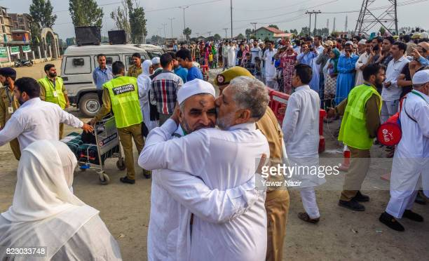Kashmiri Muslim hajj pilgrim greets his relative before departing for the annual Hajj pilgrimage to Mecca on July 26 2017 in Srinagar the summer...