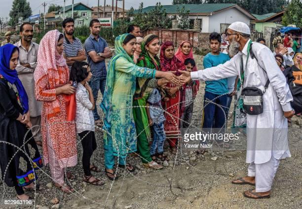 Kashmiri Muslim hajj pilgrim greets his relatives before departing for the annual Hajj pilgrimage on July 26 2017 in Srinagar the summer capital of...