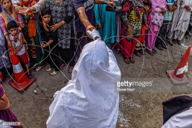 Kashmiri Muslim hajj pilgrim greets relatives before departing for the annual Hajj pilgrimage on July 26 2017 in Srinagar the summer capital of...