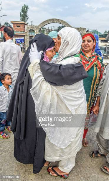 Kashmiri Muslim hajj pilgrim hugs and kiss forehead of her relative before departing for the annual Hajj pilgrimage on July 26 2017 in Srinagar the...