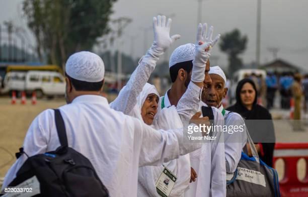 Kashmiri Muslim hajj pilgrim waves to relatives before departing for the annual Hajj pilgrimage to Mecca on July 26 2017 in Srinagar the summer...