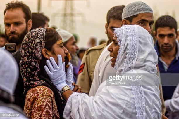 Kashmiri Muslim hajj pilgrim wipes tears of her daughter before departing for the annual Hajj pilgrimage on July 26 2017 in Srinagar the summer...